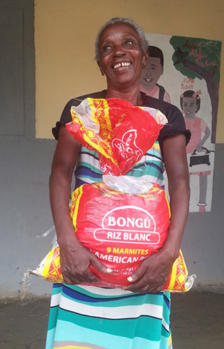Haitian woman receives food in hurricane relief effort.